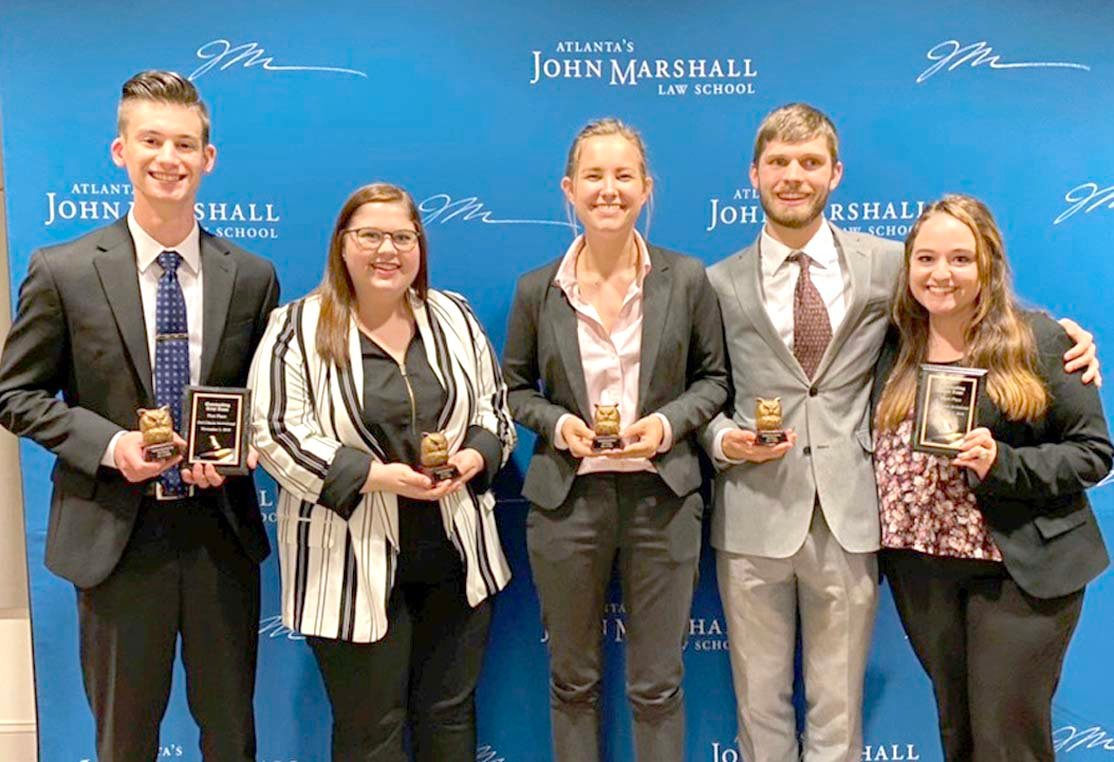 Society for Law and Justice members receiving awards at the competition, from left, (left Ben Wycoff, Lydia Burton, Madelaine Burgess, William Fulford, and Katie Philyah.