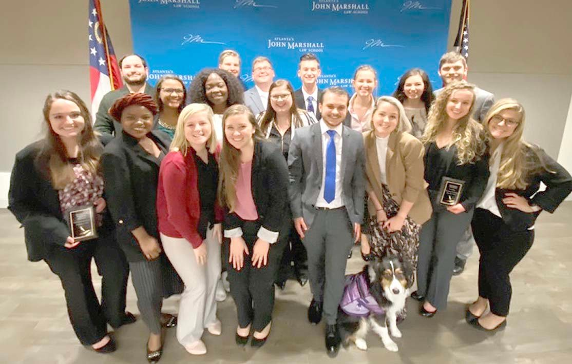 Lee's Society for Law and Justice members pose after competition. From left, back, are Malakai Cebrera, Graham Stewart, Chase Lawson, and Ben Wycoff; middle, Mimi Paul, Ibi Oduguwa, Lydia Burton, Madelaine Burgess, Delaney Bryant, and William Fulford; and, front, Katie Philyah, Tami Bankcole, Alison Holley, Alex French, Skylar Burton, Clara Politino, Alex Clark, and Maddie Bennedict.