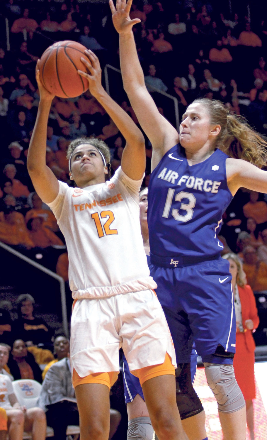 Tennessee's Rae Burrell (12) drives to the basket for a layup against Air Force's Emily Conroe (13), Sunday, during an NCAA game in Knoxville.