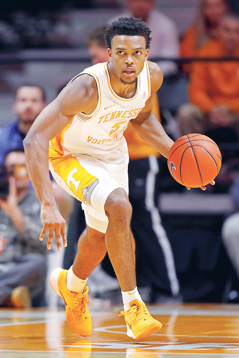 TENNESSEE guard Josiah-Jordan James (5) brings the ball up court against Florida A&M, in Knoxville.