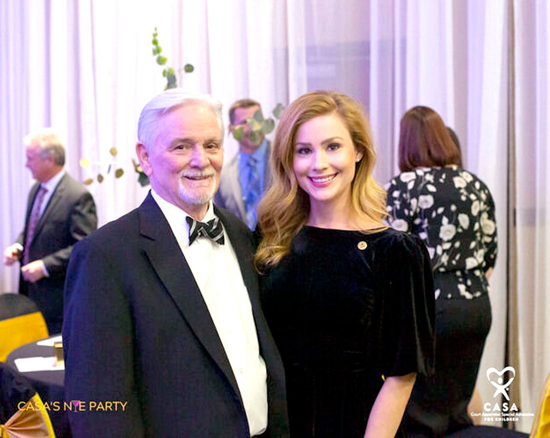 Buddy Simpkins (board chair 2020) and Katie Jones (event committee member) discuss the success CASA New Year's Eve Party.