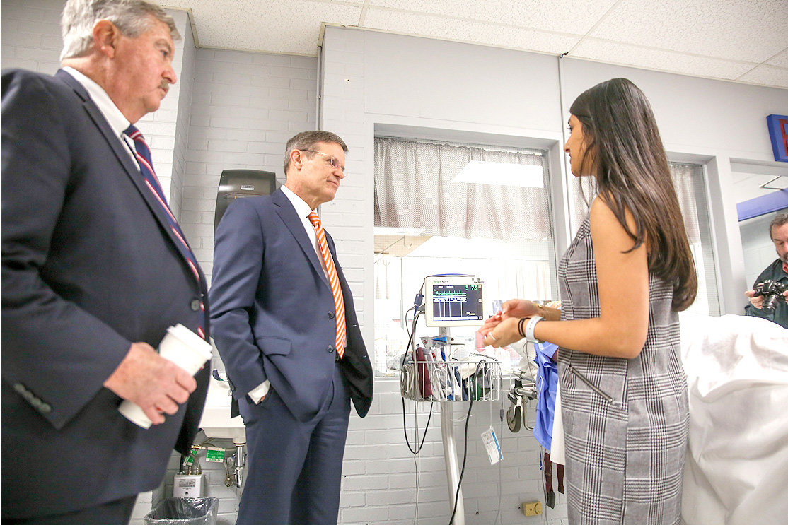 GOV. BILL LEE, center, along with Lt. Gov. Randy McNally, left, speak with Cleveland High School senior Siddhi Patel inside one of the emergency medical services training rooms. Lee visited CHS last week to tour the school's Career & Technical Education program. Doug Berry, vice president of economic development at the Cleveland/Bradley Chamber of Commerce, said tech-savvy jobs are going to be a key over the next decade.