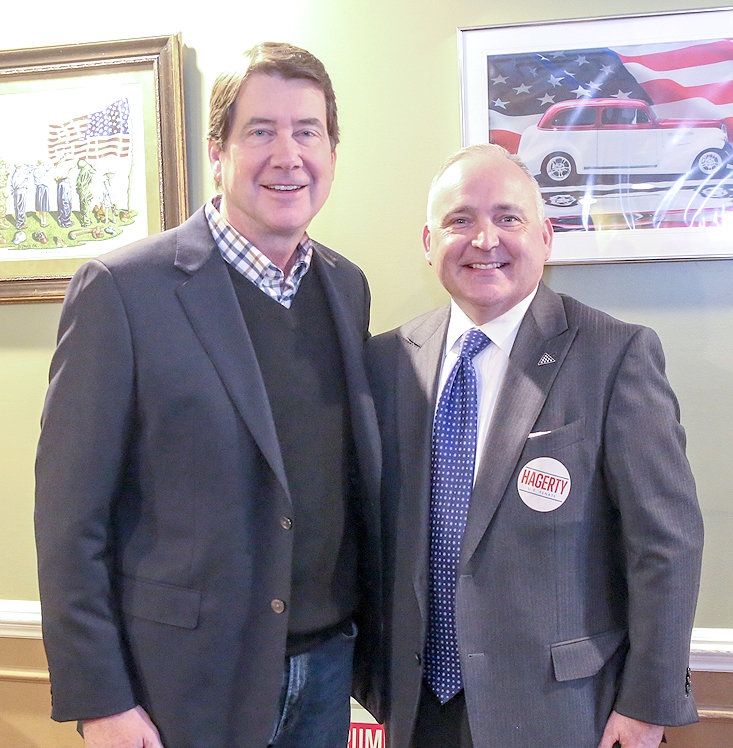 CLEVELAND MAYOR Kevin Brooks, right, stands with former U.S. Ambassador and current U.S. Senate candidate Bill Hagerty during a campaign stop in Cleveland Thursday. When Brooks was a state representative, he said he worked with Hagerty in Nashville when the senate candidate was commissioner of the Tennessee Department of Economic and Community Development.