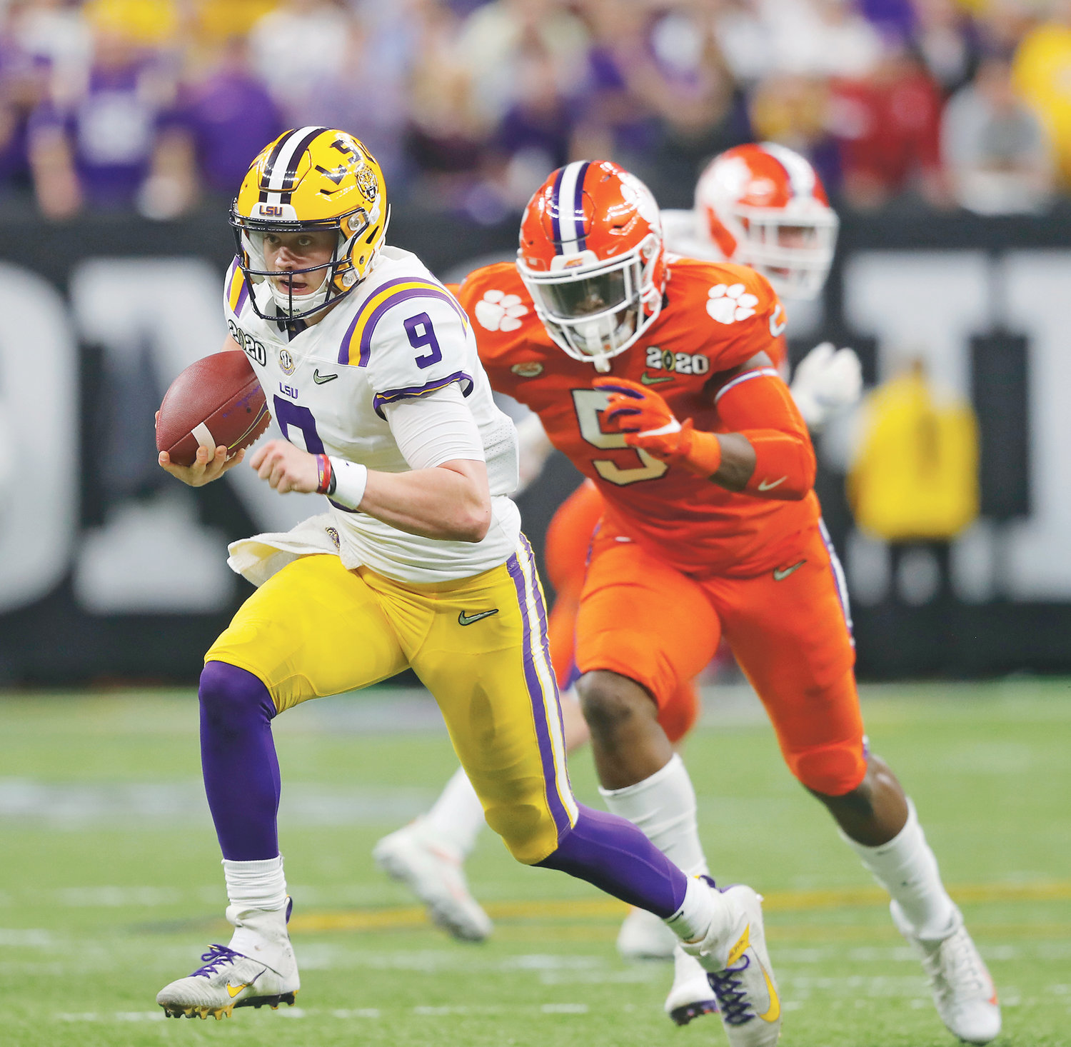 LSU QUARTERBACK Joe Burrow runs against Clemson in the first half of the NCAA championship game Monday, in New Orleans.