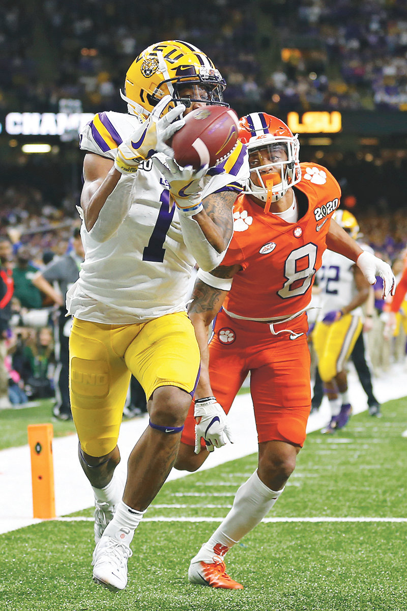 LSU wide receiver Ja'Marr Chase catches a touchdown pass in front of Clemson cornerback A.J. Terrell in the first half Monday, in New Orleans.