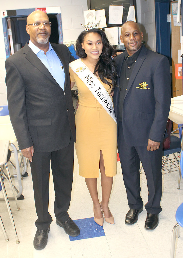 President Ralph White, left, of the 100 Black Men of Bradley County, and Immediate Past President Jonathan Porter, right, are shown with Miss Tennessee Brianna Mason at Cleveland Middle School Friday morning.
