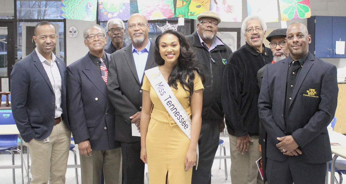 LEADERSHIP OF THE 100 Black Men of Bradley County pose with Miss Tennessee Brianna Mason during her visit to Cleveland Middle School's Mentee Program Friday morning. The program has continued to grow in recent years at the middle school.