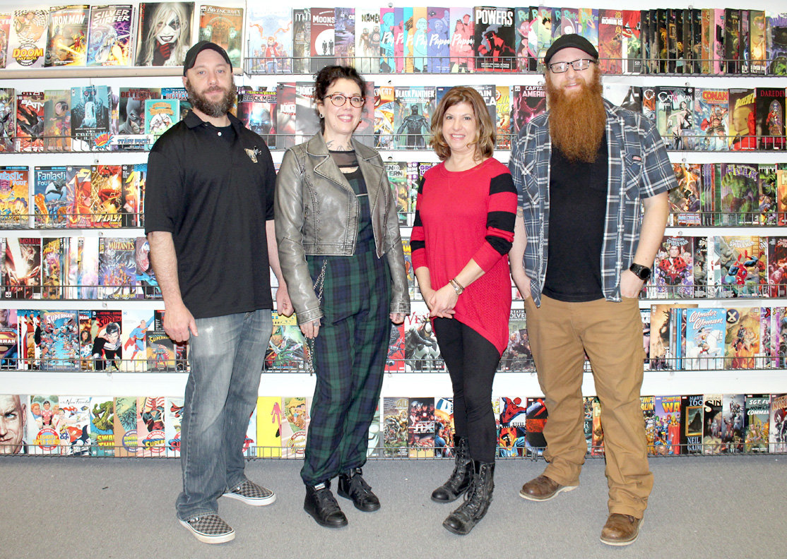 "ORGANIZERS of the upcoming Comic Book/Pop Culture Art Show gather. From left are Dicehead Games & Comics owner Shane Grubb, Hetzel Art Studio & Gallery co-owner Beth ""M.B."" Hetzel, Hetzel Art Studio & Gallery co-owner Beck Fowler and Dicehead Games & Comics manager Chad Taylor."