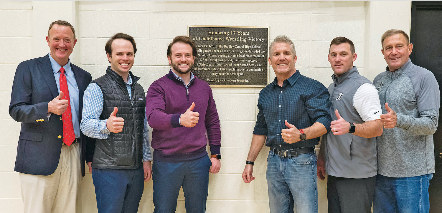 FORMER BRADLEY BEARS wrestling coach Steve Logsdon was honored with a special plaque from the Allan Jones Foundation in Jim Smiddy Arena at Bradley Central High School this week. From left, Toby Pendergrass, Allan Jones Foundation; Will Jones, Vice President of Check Into Cash and Jones Properties; J. Bailey Jones, Vice President at Check Into Cash; Steve Logsdon, former Bears coach; Patrick Spangler, Bradley Central principal; and Turner Jackson, Bradley Central athletics director.