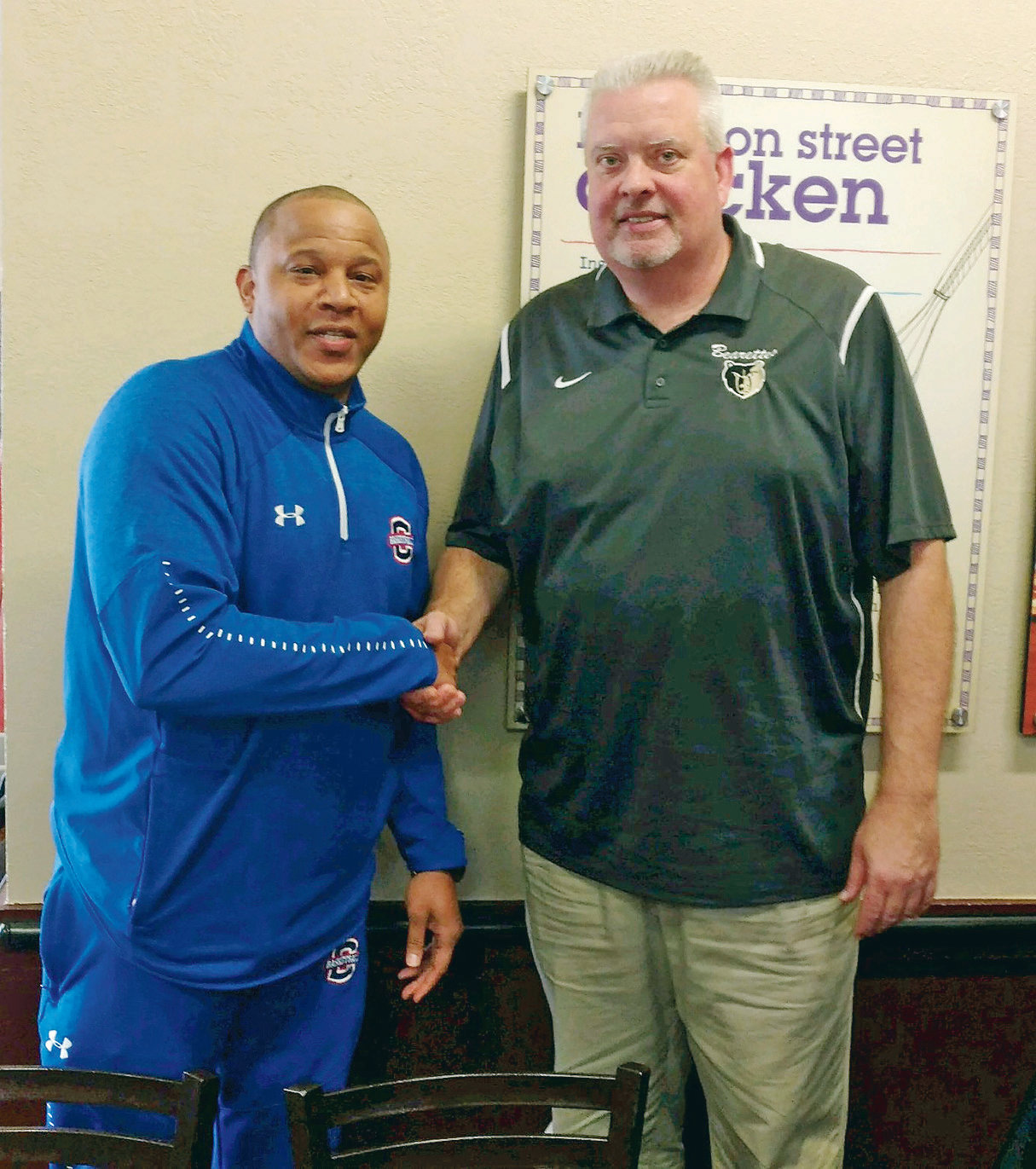"DISTRICT -5AAA Coaches of the Year honors went to Cleveland High High first-year mentor Reggie Tucker, left and veteran Bradley Central ""Papa Bear"" Jason Reuter during Wednesday's coaches meeting. Both the Runnin' Raiders and Bearettes have been ranked No. 1 in the AP State Poll all season."