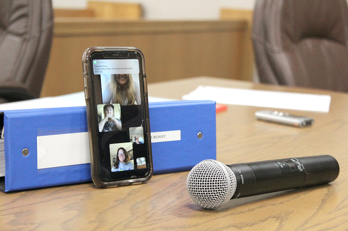BRADLEY COUNTY commissioners Erica Davis, from top, Cindy Slater, Milan Blake and Charlotte Peak join in a video conference call for Monday's IT Committee meeting. A microphone was set up in front of the smartphone so the people in the meeting room could hear what the commissioners were saying.