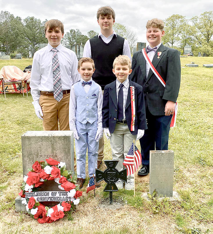 MEMBERS OF the Children of the Confederacy pose during a grave-marker ceremony. They are, front from left, Ethan Peden, Zeke Pritchett;  back,  Luke Peden, Caleb Peden and Jed Pritchett.