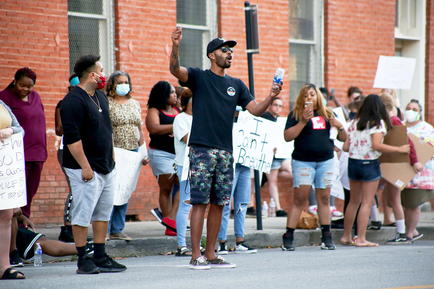 TERRENCE DAVIS speaks to CPD officers posted outside the Cleveland Police Department on Sunday during the protest.