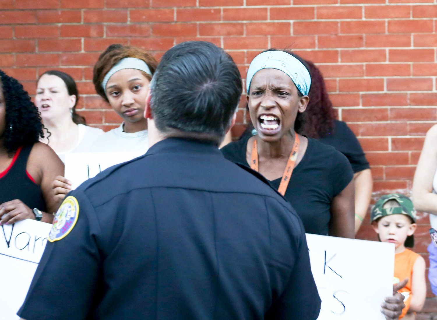 CPD POLICE CHIEF MARK GIBSON speaks to an angry protester Sunday in front of the Cleveland Police Service Center.