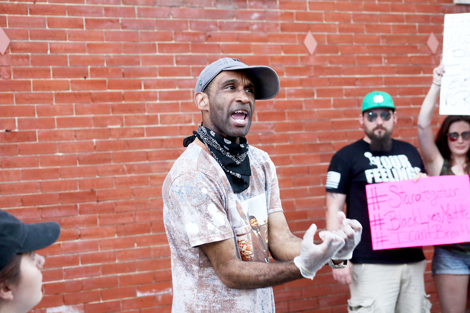 A PROTESTER voices his concerns during the protest on Church Street in front of the Cleveland Police Service Center.
