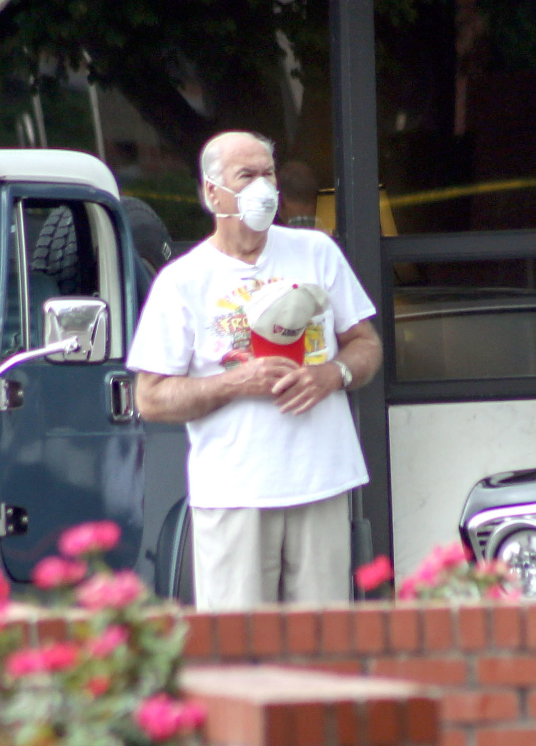 SOME ATTENDEES, such as this gentleman pausing for the pledge or allegiance, wore masks to the first Cruise-In of the season amidst the ongoing pandemic.