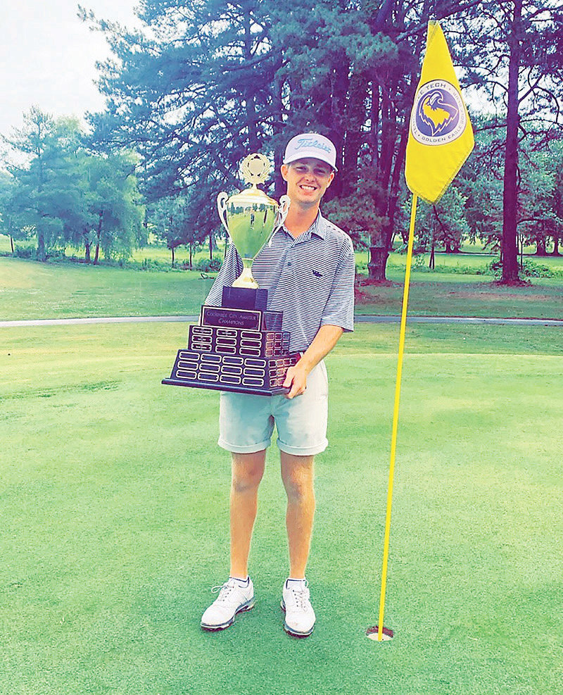 CSCC GOLFER Wes Spillers poses with the winner's trophy after finishing first overall at the Cookeville City Amateur Tournament at Golden Eagle Golf Club, in Cookeville.