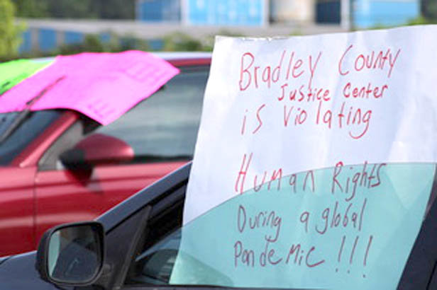 THE SIGN in the photo was one of several outside the Bradley County Jail on Monday, where two women were protesting conditions inside the complex. Both have loved ones who are inmates there.