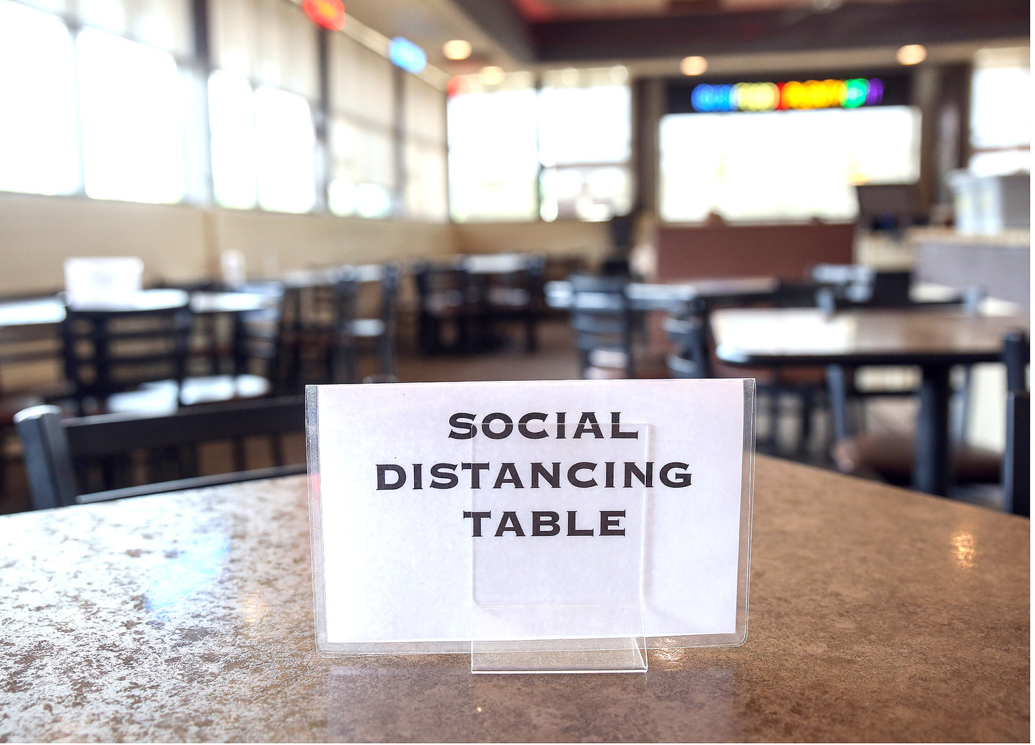 A SIGN blocks a table at a restaurant in Bradley County. Many restaurants have been forced to close tables in their dining rooms so customers may social distance while dining in.