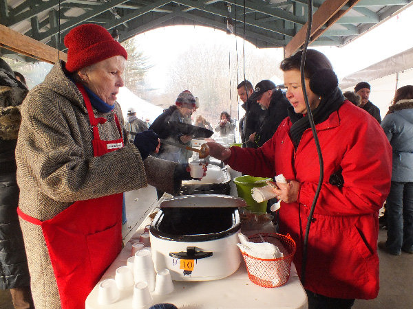 Rotarian Stephanie King (L) serves up a hot cup of chili.