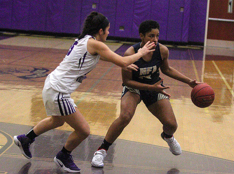 Alera Jicha tries to move the ball against the Crusaders.
