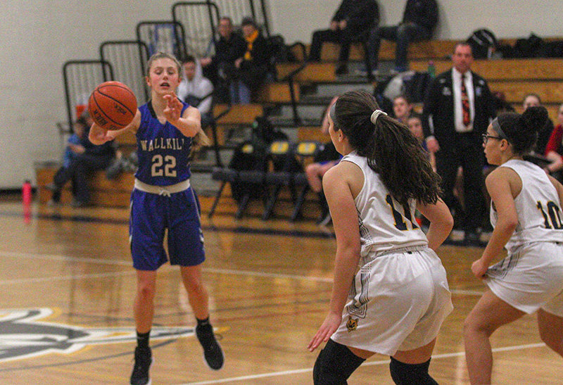 Emma Spindler passes the ball for Wallkill.