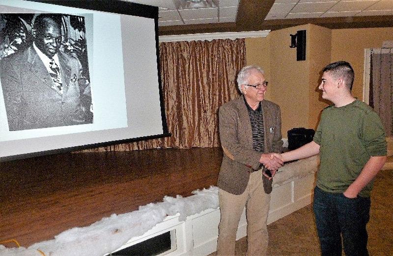 Speaker Rik Rydant greets TOLHPS member Hudson Peplow after Rydant finished his presentation.