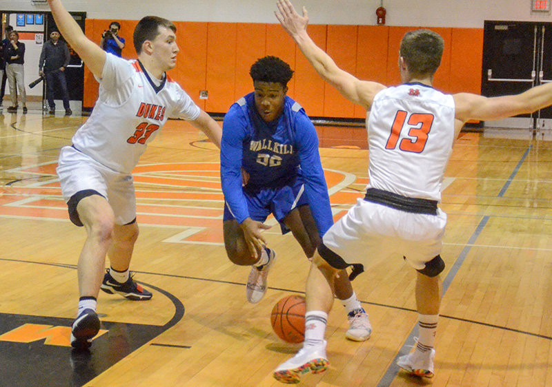 Jaylan Perrin drives past Marlboro's A.J. Mussacchio (33) and Giovanni Tamburri during Friday's MHAL boys' basketball game at Marlboro High School.