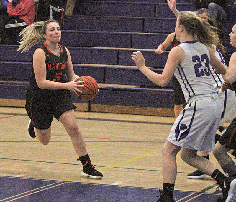 Lauren Schwarzbeck drives to the basket for Marlboro.