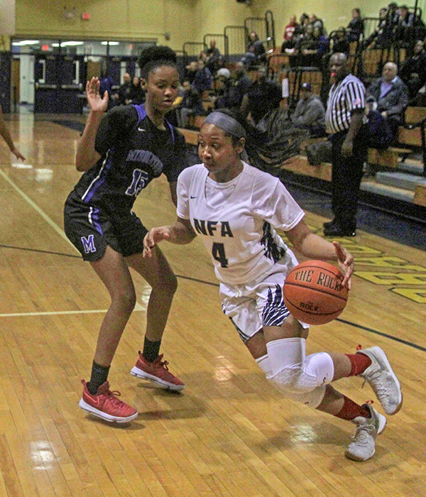 E'layasia Williams drives the ball for Newburgh.