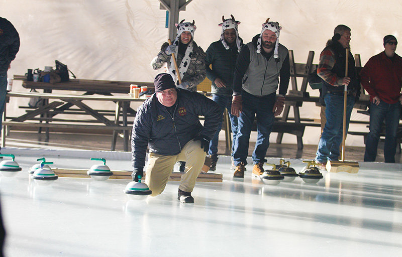Eric Orr slides the stone for a team from Wallkill's fire departmen, Saturday during the annual Walkill Lions Curling Tournament.