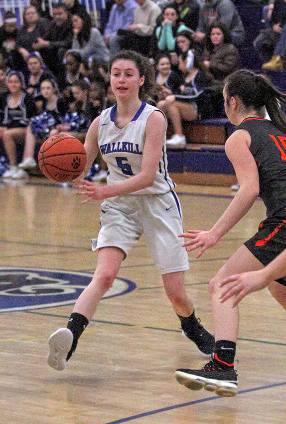 Angelina Bartelt passes the ball for Wallkill.