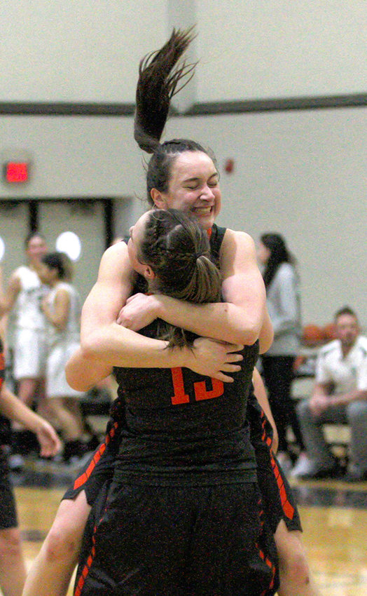 Elizabeth Lofaro and Erin Lofaro celebrate Marlboro's sectional title.