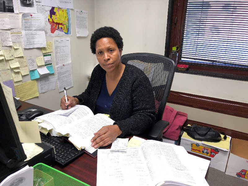 Tamie Hollins does the work of two in her office.