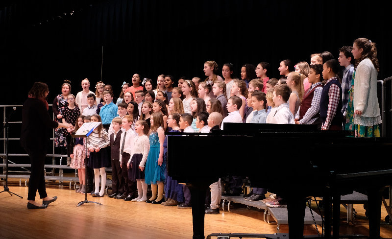 The 4th grade chorus, under the direction of Jodie McCaffery, sang 'Castle On A Cloud' at the 60th Annual Highland Scholarship concert.