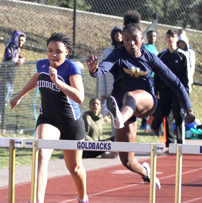 Sania Kuylen, on the right in the 100-hurdles, ran on Newburgh's winning 400-meter relay team.