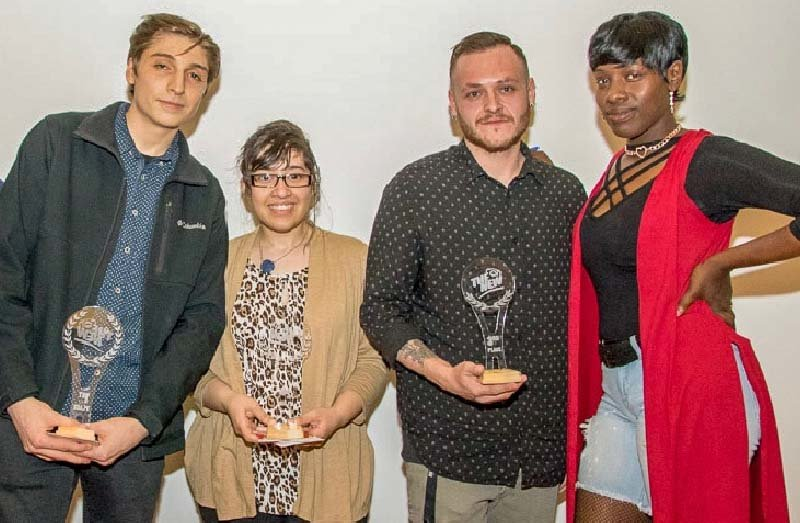 """The New"" Winners – Film award winners (from left to right): SUNY New Paltz student Joshua Dudzik (3rdplace), Newburgh Free Academy student Anais M. Cantres (2ndplace) and winner Brandon DeSouza from Pine Bush High School with event MC, Moochie Merchant."