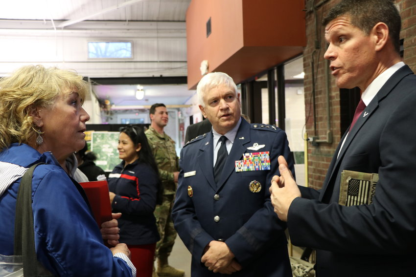 Scott Rice  (c) Lt. Gen. Director of the Air National Guard, and John Henderson (r), Assistant Secretary of the U.S. Air Force speak to residents at the Newburgh Armory Unity Center on Thursday, April 18 in the wake of another contamination by Atlantic Aviation at Stewart International Airport.
