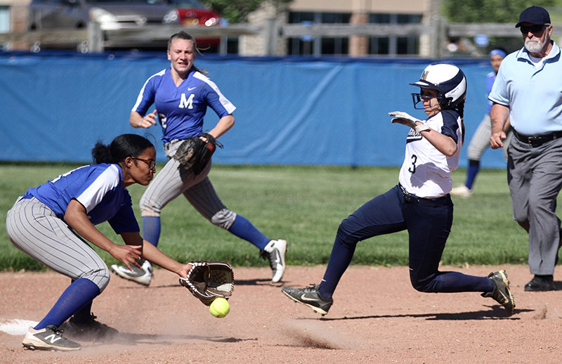 Angie Clarino beats this throw to second base.