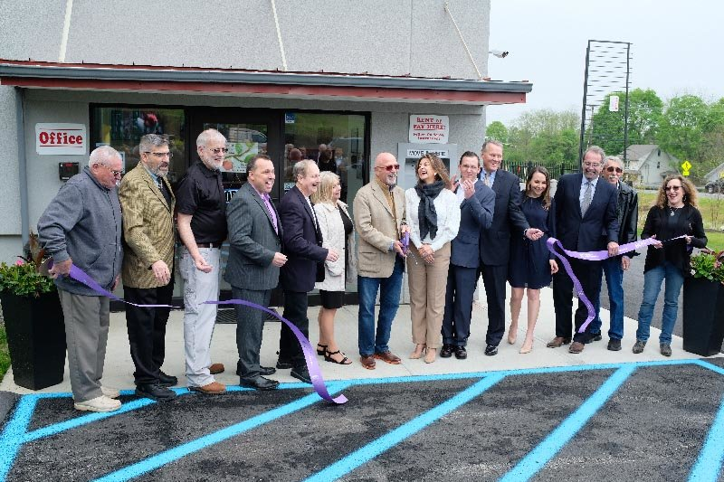 Highland Route 9W Self Storage owners, Mark and Diana Sanderson, cut the ceremonial ribbon to officially mark the opening of their facility. Pictured L-R unidentified man then  Charles Glassner, Mike Ashe (Manager), Domenic Baiocco, Paul Cohen, Donna Virga, Mark Sanderson and wife Diana Sanderson (Owners), Bill Hurley (Manager), Richard Kolosky, Jessica Glass, Kenneth Stenger, Lenny Auchmoody and Miriam Gibbons.