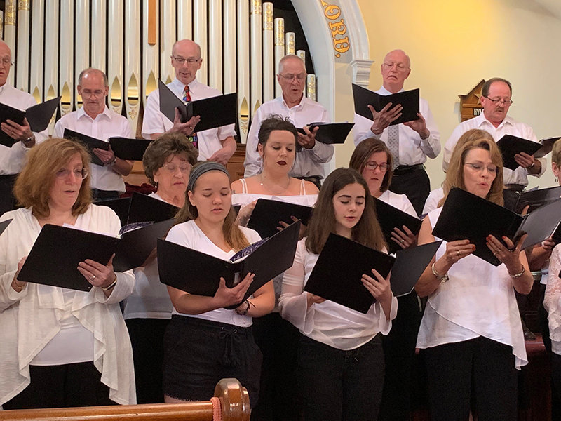This past Sunday, singers from area churches sang in a church choir concert to commemorate the church's 150th anniversary. Photo by Laura Fitzgerald