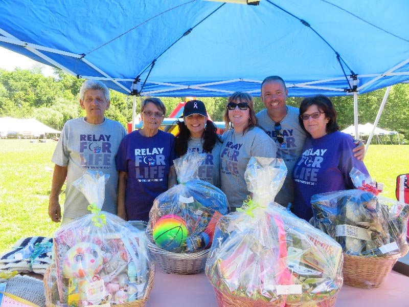 Carl Fiorelli, Petra Fiorelli, Leza Bowman, Maureen Piotti, Eric Fiorelli and Betty Hannigan volunteer at the Pine Bush Relay for Life.