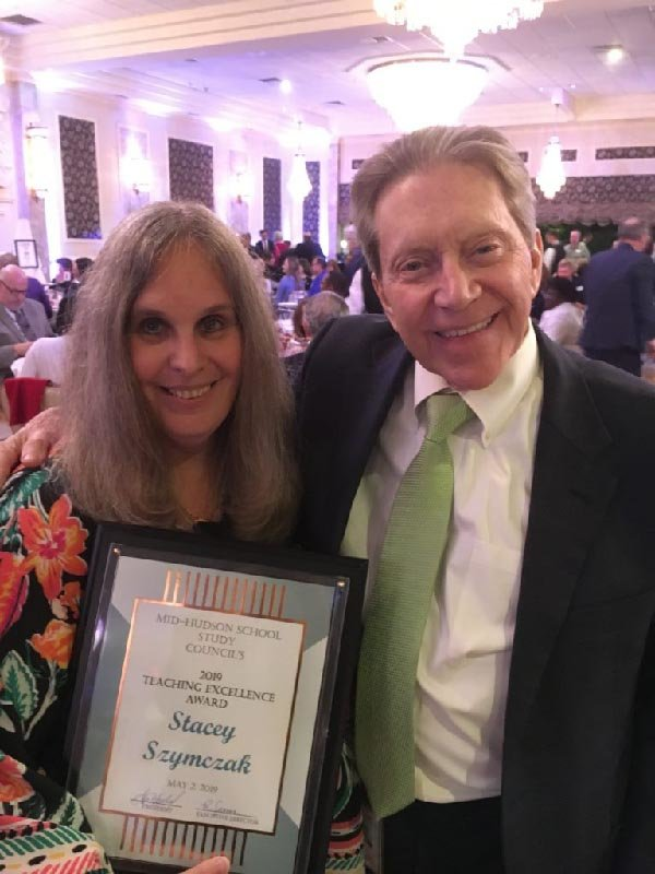 Stacey Szymczak is all smiles after receiving her excellence in teaching award from the Mid-Hudson School Study Council.