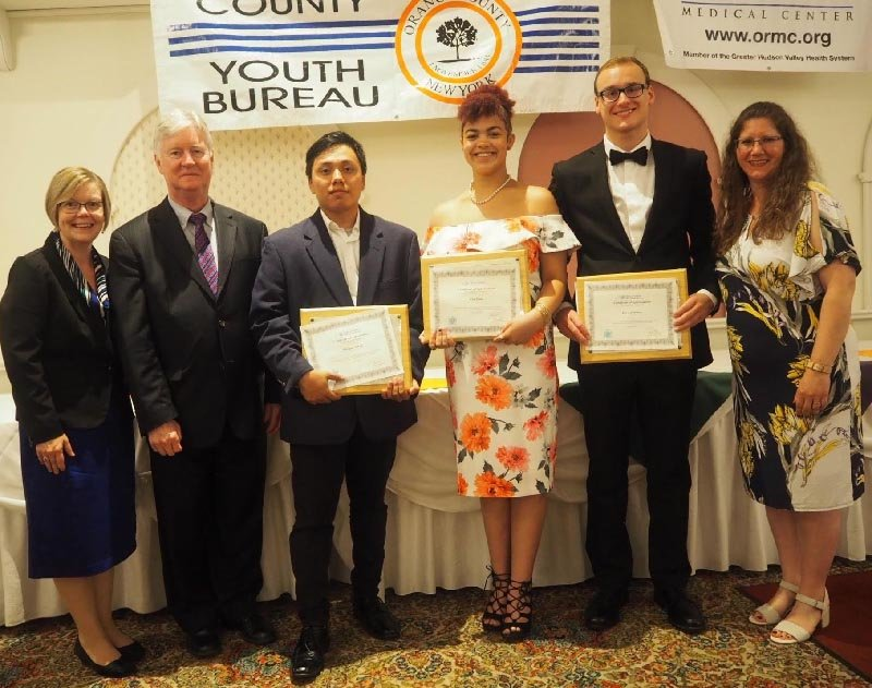Lynn Tubbs, Youth Local Assistant Specialist with New York State Office of Children and Family Services; Deputy County Executive Harry Porr, Youth Board Advisory Board members Michael Torres, Cloe Fain, Ian Ackerman and Youth Bureau Director Rachel Wilson.