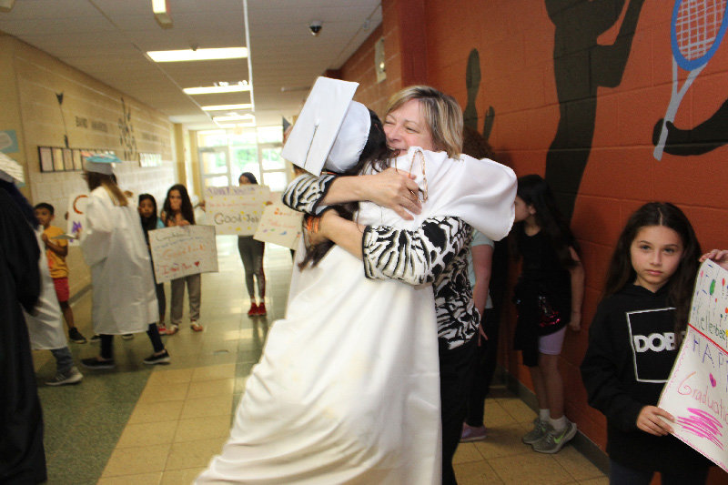 Marlboro High School student embraces her former teacher, Ms. Marion Lyons.