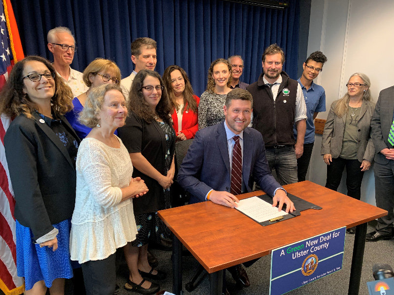 Ulster County Executive Pat Ryan signs renewable energy Executive Order.