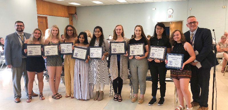 Highland's Top 10 students in the class of 2019 pose with administrators. Pictured: Teresa Mazzella: Attending Marist College, majoring in business, minor in political science,   Megan Finn: Attending Coastal Carolina University, majoring in biology;, Nicola Wilk: Attending the University of Connecticut, major is undecided, Tanmaye Hulgundi: Attending Binghampton University, majoring in engineering, Jasmin Akter: Attending SUNY New Paltz, majoring in biology, Rylee Montelione: Attending Hofstra University, majoring in marketing, Cassidy McMann: Attending SUNY College of Environment Science and Forestry, majoring in Environmental Science. Salutatorian- Marie Ling: Attending Colby College, double major in psychology and spanish.   And Valedictorian - Carlie Relyea: Attending Drexel University, double major in biology and psychology. Not pictured: Sofia Crimivaroli: Attending University of Notre Dame, majoring in architecture.