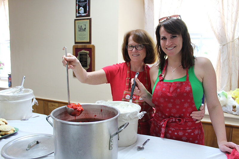 Carolyn Baker and daughter Marie handled some of the cooking chores.