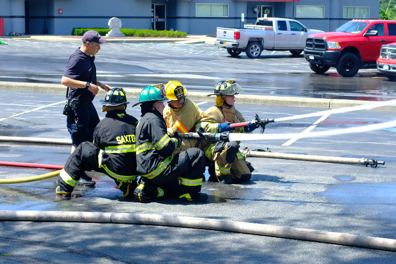 Fire Instructor Jeff DiMetro teaches how to properly use the different nozzles and hoses to knock down a fire.