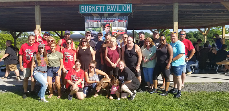 Some of the committee members who put together the event pose for a group photo at the 2018 Jimmy's Truckin' Tribute.